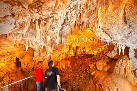 Tourist visitors enjoying the limestone cave formations